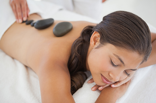 hot therapy massage stone on back soothing pain relief